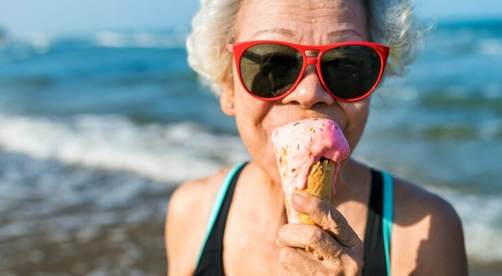 Retired woman eating an ice cream cone