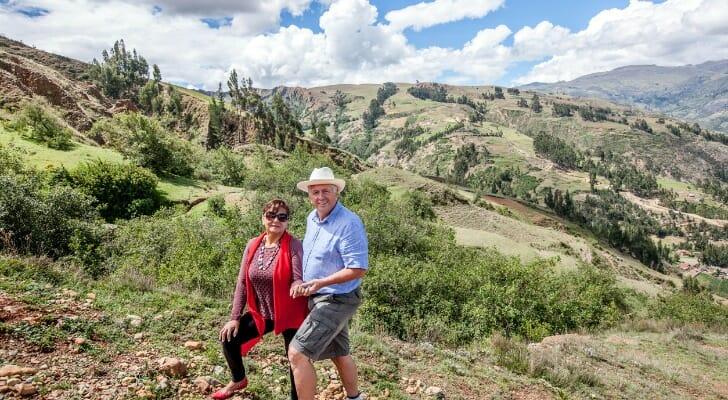 Mature couple on a hike through the countryside above Huaraz, Peru