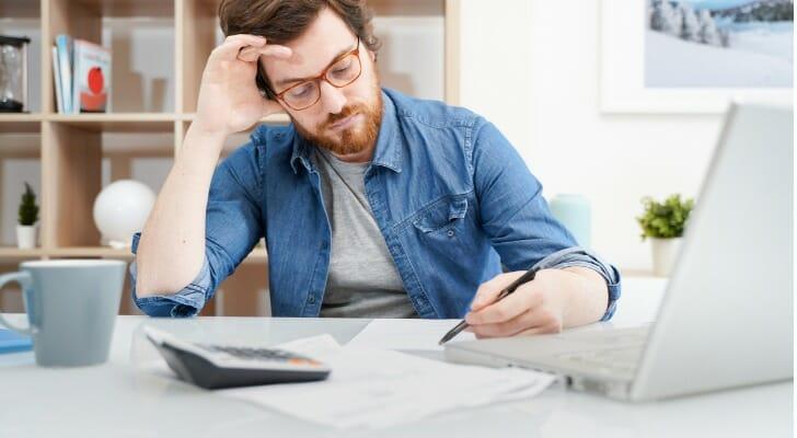 A man prepares for the Series 3 exam