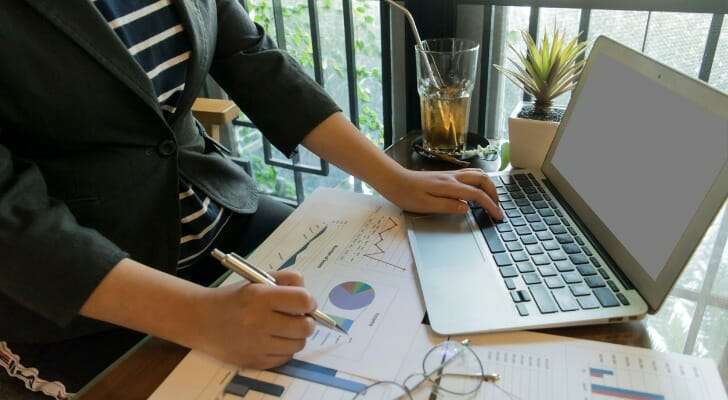 A financial professional evaluates a client's portfolio.