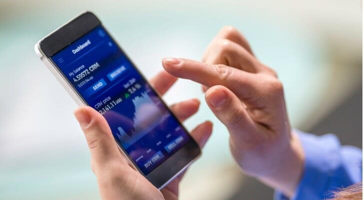 A woman runs a VWAP app on her smart phone.