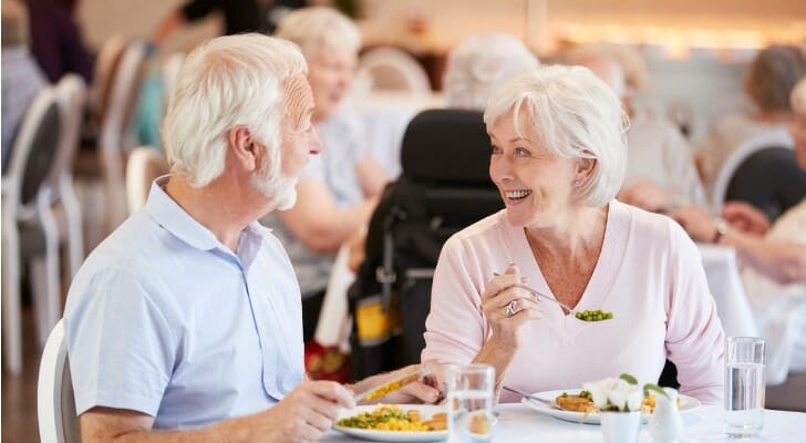 Couple enjoys a meal at an one of the best active retirement communities